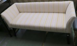 An upholstered window seat with mahogany legs, 63cm high x 126cm wide x 48cm deep Condition