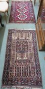 A red ground Hamadan rug 152cm x 80cm and a baluch rug 132cm x 73cm (2) Condition Report: