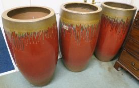 Three very large modern red glazed garden planters, 89cm high x 44cm diameter (3) Condition