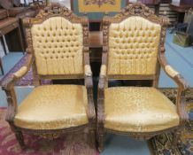 A pair of heavily carved gilt framed armchairs with a golden fabric (2) Condition Report: