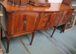 A reproduction mahogany serpentine front sideboard, 90cm high x 188cm wide x 56cm deep Condition