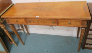 An inlaid desk with three frieze drawers on square tapering legs, 76cm high x 115cm wide x 43cm deep
