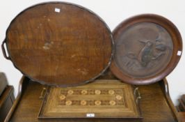 An inlaid tray, oval tray and a carved bird in circular frame (3) Condition Report: Available upon
