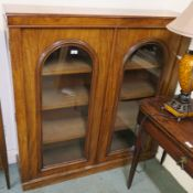 A Victorian mahogany two door glazed bookcase, 129cm high x 123cm wide x 32cm deep Condition Report: