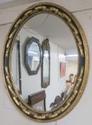 An oval gilt wall mirror, 77cm x 96cm and another gilt mirror, 101cm x 71cm (2) Condition Report: