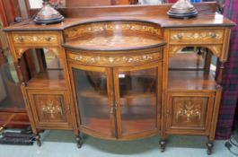 A Victorian rosewood inlaid sideboard with bow front glazed doors flanked by two drawers, open