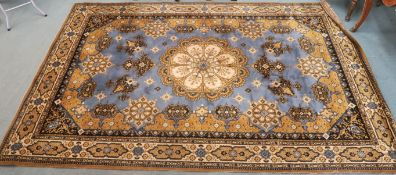 A blue ground Louis de Poortere rug with central medallion, 200cm x 300cm Condition Report: