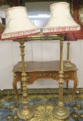 Two gilt standard lamps (2) Condition Report: Available upon request