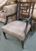 An Aesthetic Movement ebonised wood low chair, in the manner of E W Godwin, the back with
