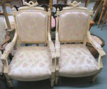 A pair of cream armchairs upholstered with a floral fabric (2) Condition Report: Available upon