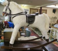 A small modern rocking horse, 76cm high Condition Report: Available upon request