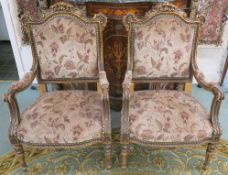 A pair of gilt framed ornate open armchairs with floral upholstery (2) Condition Report: Available