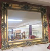 A modern gilt ornate wall mirror, 110cm x 130cm Condition Report: Available upon request