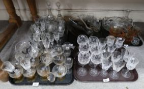 A collection of drinking glasses including Stuart hock glasses, two antique decanters and other