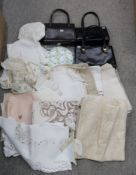 Four ladies handbags and assorted table linen Condition Report: Not available for this lot