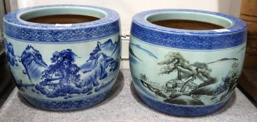 A pair of Chinese pottery jardiniere's with painted decoration Condition Report: