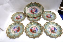 An Aynsley dessert service comprising six plates, 20cm diameter and a serving dish, painted with