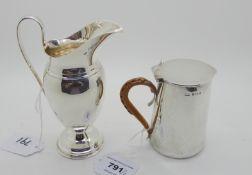 A lot comprising a silver lidded jug, Birmingham 1903, 9cm high and a silver helmet shaped cream