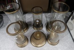 Two large glass hurricane lamps, an extra base and three smaller examples Condition Report: Not