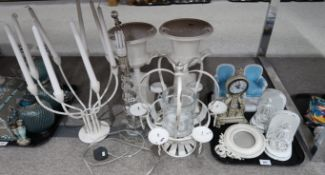A pair of white painted birdcage bookends, pair of pottery urns, white candelabras, acrylic ball