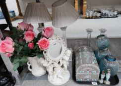 A pair of cream table lamps, a jewellery chest, a cherub mirror, blue glass candleholders etc