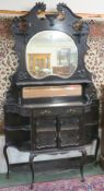 An ebonised sideboard with mirror back, 215cm high x 120cm wide x 33cm deep Condition Report: