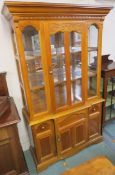A modern display cabinet with single glazed door over a base with single door, 197cm high x 116cm