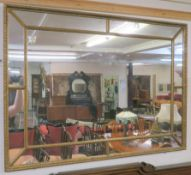 A gilt wall mirror, 85cm x 115cm Condition Report: Available upon request