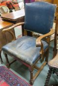 An oak armchair with carved arms, 98cm high Condition Report: Available upon request