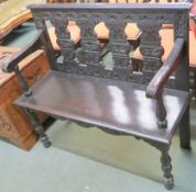 A stained oak hall bench with carved back and arms, 94cm high x 107cm wide x 40cm deep Condition