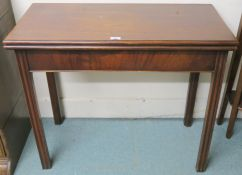 A mahogany fold over tea table, 74cm high x 89cm wide x 43cm deep Condition Report: Available upon