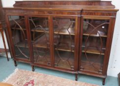 A mahogany breakfront bookcase with four glazed doors on square tapering legs, 130cm high x 183cm
