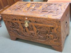 A heavily carved Chinese camphorwood chest, 59cm high x 101cm wide x 52cm deep Condition Report: