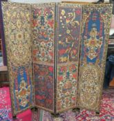 A decorative four fold screen, one side with stylised flowers and the other side with an ornate