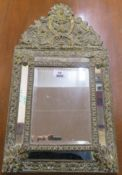 A small brass cushion mirror, 60cm high x 32cm wide Condition Report: Available upon request