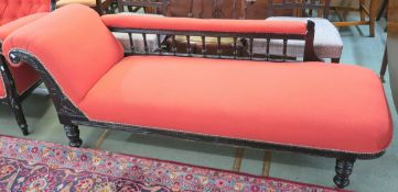 A Victorian chaise longue with painted black frame, 68cm high x 182cm wide x 60cm deep Condition