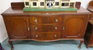 A mahogany sideboard with three drawers flanked by two doors, 119cm high x 182cm wide x 60cm deep