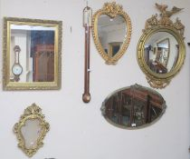 Four gilt wall mirrors and an oval wall mirror (5) Condition Report: Available upon request