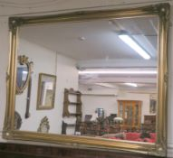 A modern gilt framed mirror, 107cm x 138cm Condition Report: Available upon request