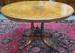 A Victorian walnut inlaid oval table, 72cm high x 113cm wide x 80cm deep Condition Report: Available