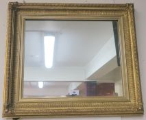 A gilt framed wall mirror, 59cm x 51cm Condition Report: Available upon request