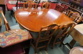 A reproduction dining table with two leaves, 76cm high x 282cm wide x 108cm wide with six dining