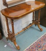 A Victorian walnut side table with turned supports and stretcher, 71cm high x 90cm wide x 45cm