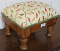A small upholstered footstool, 22cm high x 28cm wide x 22cm deep Condition Report: Available upon