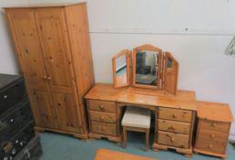 A pine bedroom suite comprising, double wardrobe, 189cm high x 90cm wide x 54cm deep, dressing