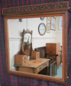 A carved oak wall mirror, 98cm high x 94cm wide Condition Report: Available upon request