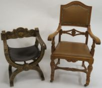 An oak armchair with leather seat and back, 119cm high and an x framed chair with leather seat (2)