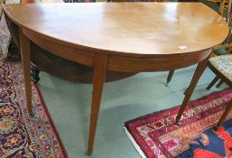 A mahogany demi-lune table with drop flap, 79cm high x 137cm wide x 62cm deep Condition Report:
