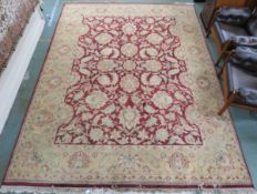 A red ground Eastern style rug with allover floral design, 370cm x 278cm Condition Report: Available