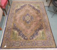 A light brown ground Eastern style rug with central medallion and matching spandrels, 200cm x